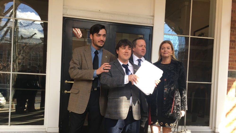 From left to right:Isaac Smith, Jason Kessler,Corey Stewart and Stewart's wife, Maria Stewart, outside of Charlottesville City Circuit Court.