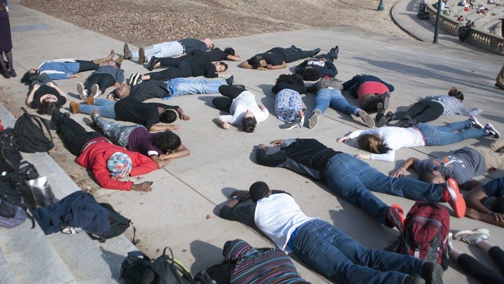 Students participate in a die-in in September 2016 to protest recent police brutality.