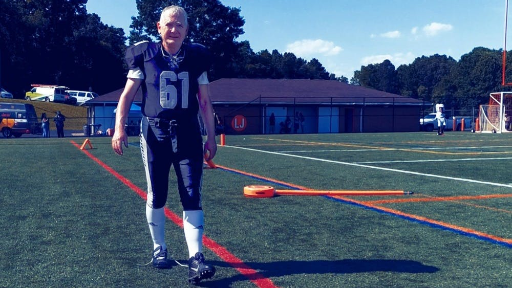 His teammates revere Lynch as a team mascot, an accomplished 61-year-old professor who is able to keep up with their exercises and help the team by scoring extra points.