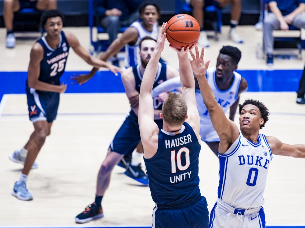 Virginia senior forward Sam Hauser shoots over Duke sophomore forward Wendell Moore.