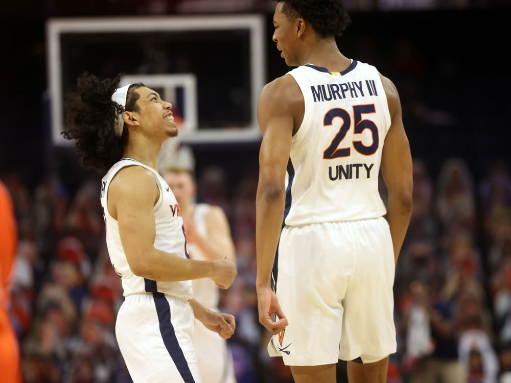 Virginia junior guards Trey Murphy and Kihei Clark celebrate a play during the game