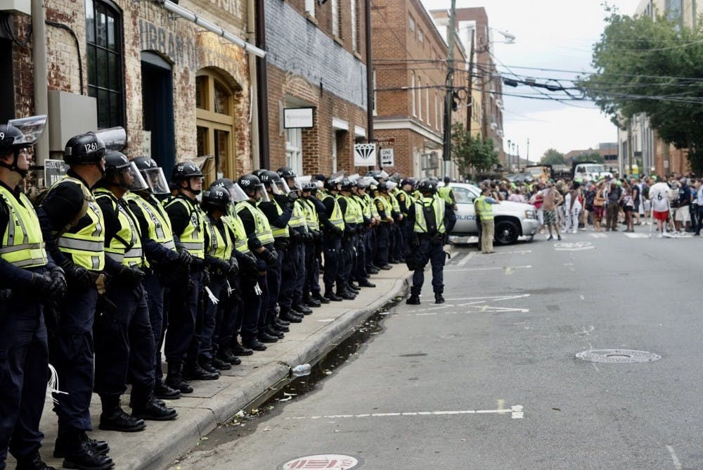 <p>Law enforcement personnel near the Downtown Mall on the anniversary of the Unite the Right rally on Aug. 12, 2018.</p>