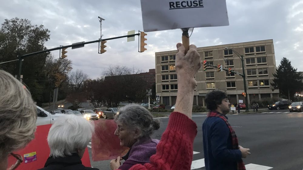 Hundreds of protesters gathered along the sidewalk in front of the Albemarle County Office Building, many holding signs expressing their opposition to appointment of Matthew Whitaker of Acting Attorney General.