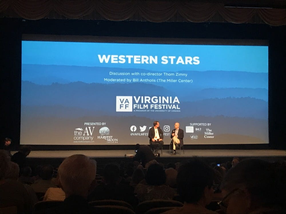 """<p>Co-director of """"Western Stars"""" Thomas Zimny spoke on stage with Miller Center Director William Antholis following the screening.&nbsp;</p>"""