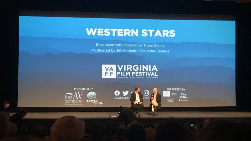 """Co-director of """"Western Stars"""" Thomas Zimny spoke on stage with Miller Center Director William Antholis following the screening."""