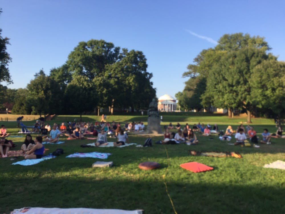 <p>At 6 p.m., participants arrived at the University's first-ever Meditation on the Lawn, ready to become peacefully-centered for one hour of their day.</p>