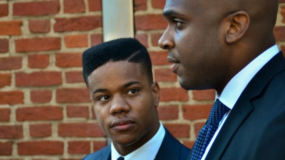 Martese Johnson, left, will continue to engage the services of attorneyDaniel Watkins, right, ashe pursues a civil suit against VirginiaABC.