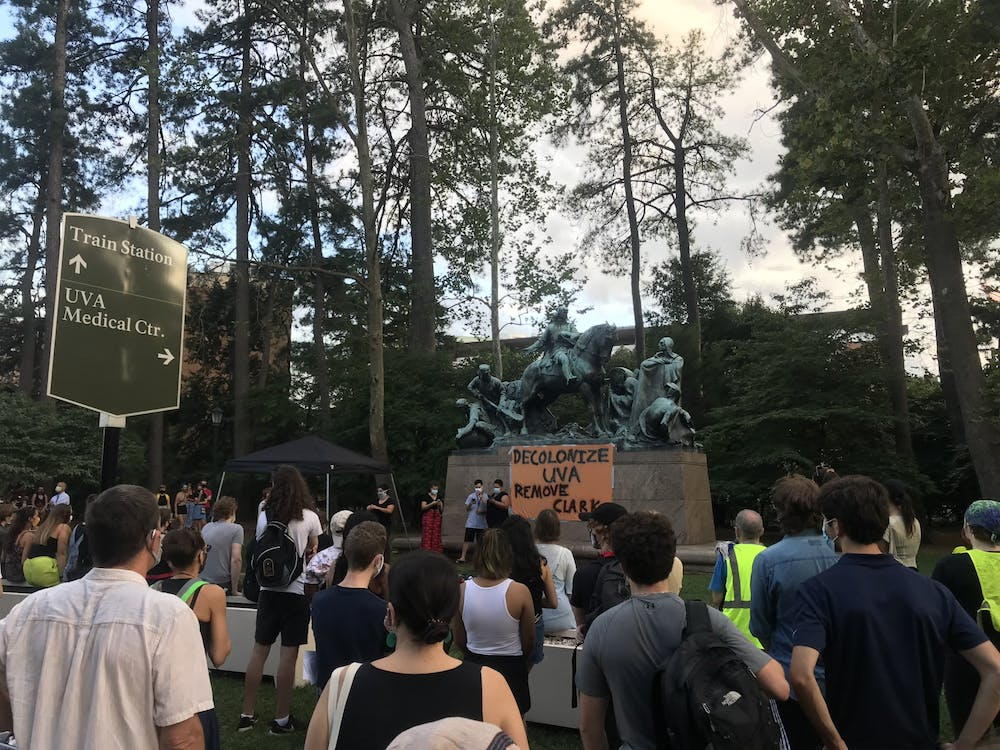 The rally occurred in anticipation of the Board of Visitors' Friday discussion on Racial Equity Task Force recommendations (Photos by Jenn Brice & Jacquelyn Kim | The Cavalier Daily)