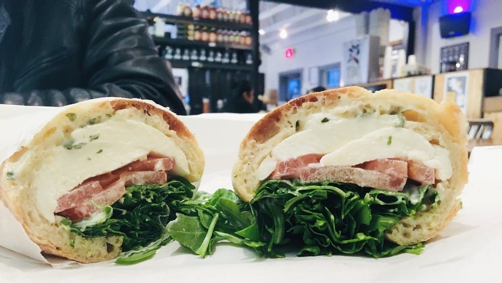 """""""I ordered the K.I.S.S. sandwich and I was thoroughly impressed. The ingredients were simple but worked well together — fresh mozzarella, tomato, arugula and basil mayo served on a baguette."""""""