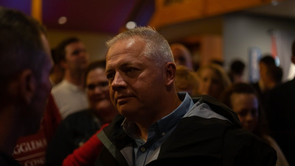 Republican Denver Riggleman speaks with supporters Tuesday night at the Blue Mountain Brewery after delivering his victory speech.