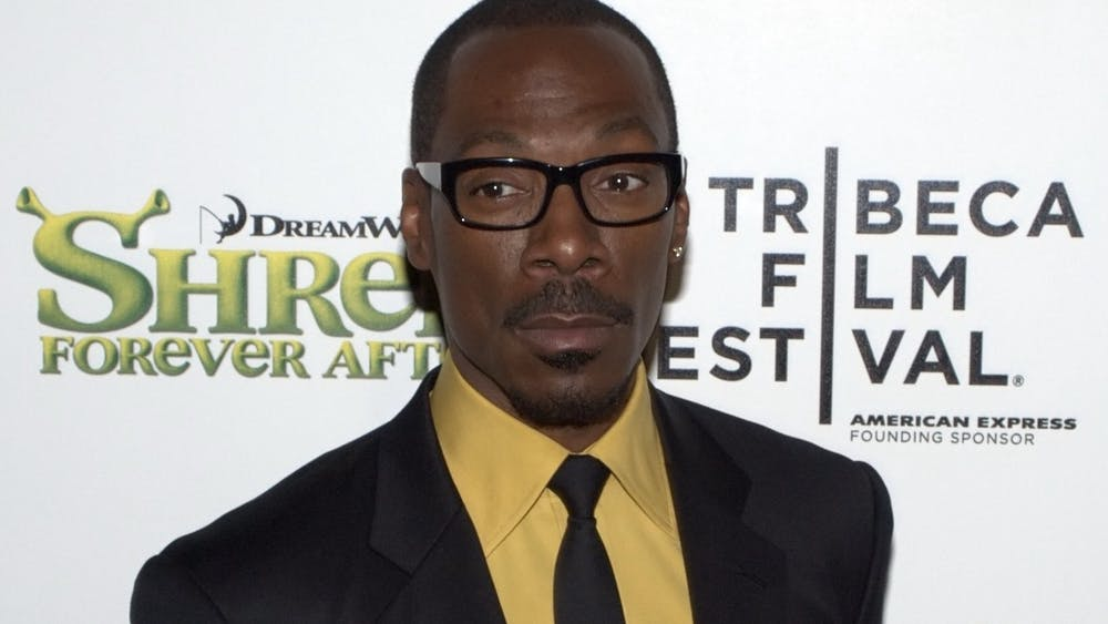 "Eddie Murphy, pictured here in 2010, brought his decades-aged comedic knowledge and charisma to the December 21 ""Saturday Night Live"" stage."