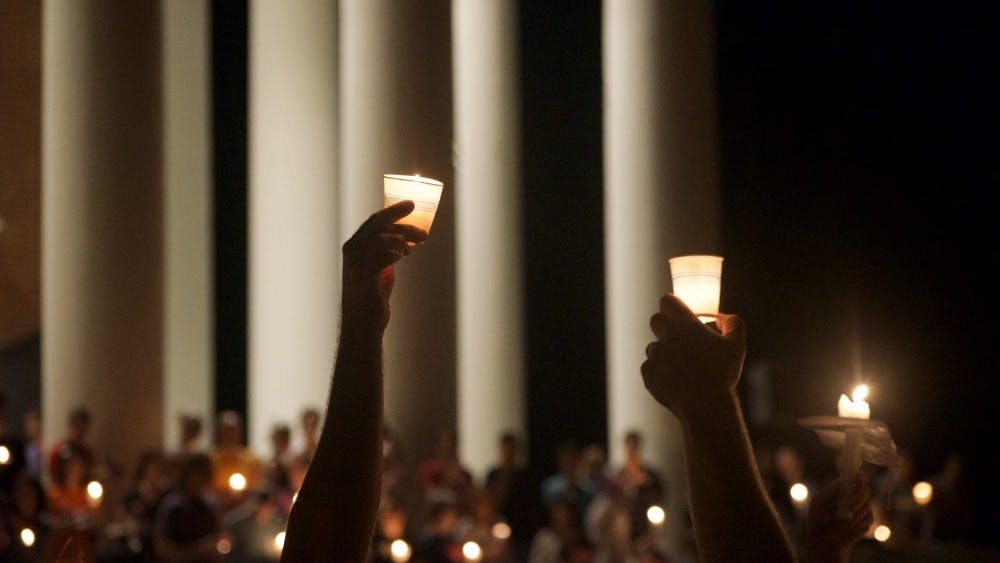 The University community came together for a candlelight vigil to oppose white supremacy and honor the memory of Heather Heyer.