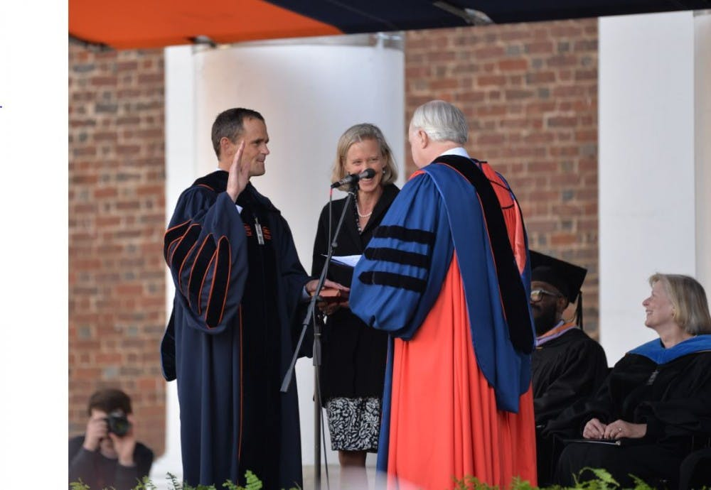 <p>University Rector Frank Conner swears in Jim Ryan as the University's ninth president.&nbsp;</p>