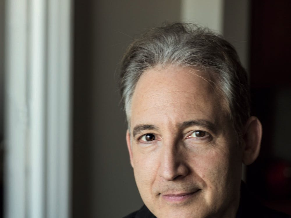 Brian Greene, professor of mathematics and physics at Columbia University, explained humankind's search for meaning through examining the history and future of the universe at his recent talk at the Paramount Theater.