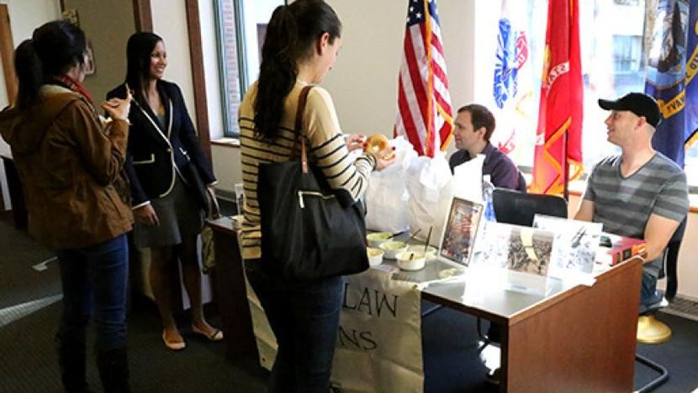 Virginia Law Veterans hand out bagels to Law students for Veterans Day.