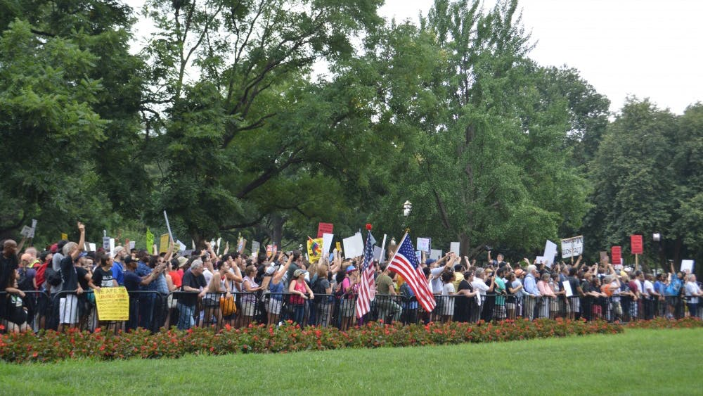 """Thousands of counterprotesters assembled in Lafayette Park in Washington, D.C. opposition to """"Unite the Right 2."""""""