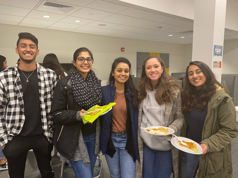 <p>Students enjoy their traditional homemade South Indian cuisine in honor of Pongal.</p>