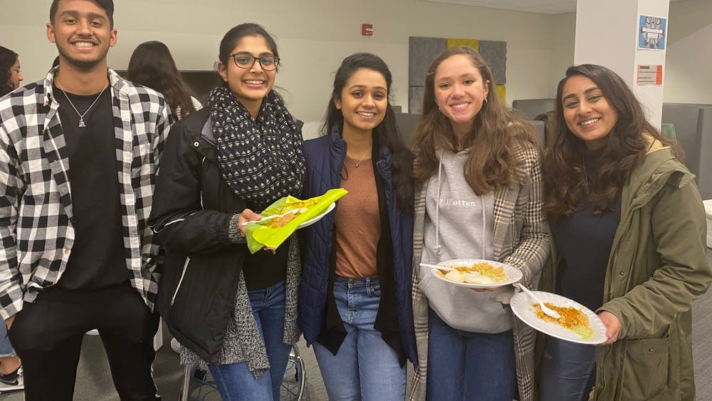 Students enjoy their traditional homemade South Indian cuisine in honor of Pongal.