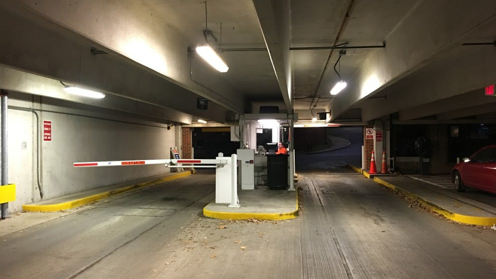 Human parking attendants frequently leave the Central Grounds Garage around 11 p.m.