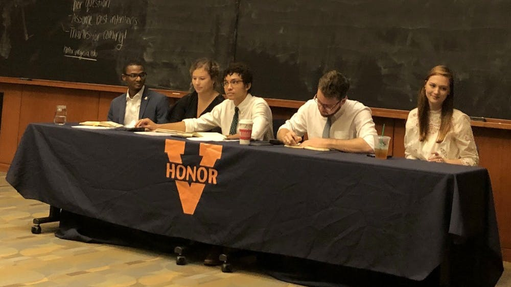 The five-person Honor panel took questions from the audience during Monday night's town hall event.