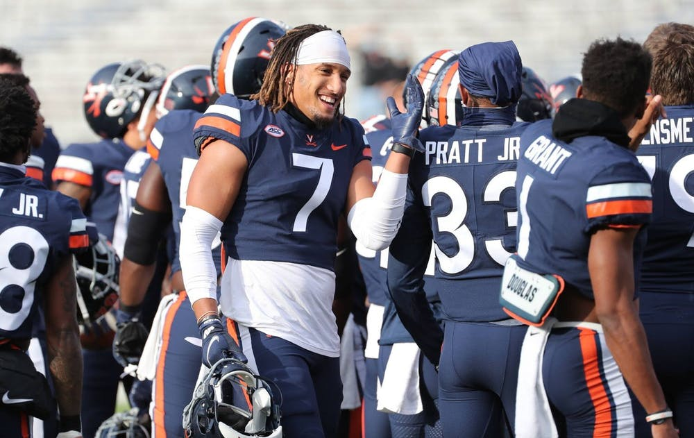 <p>Noah Taylor's 85-yard pick six was just one of the Cavaliers' five takeaways against Louisville.</p>