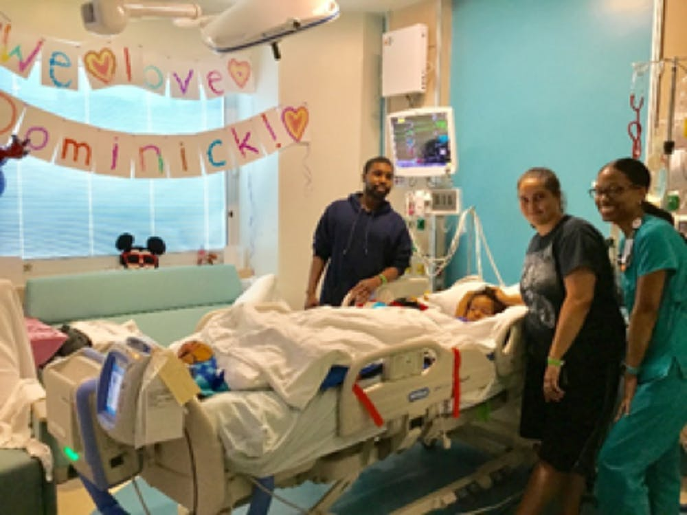 <p>Heather and Brandon pose for picture with Nurse Angie Smith. Dominick had just finished a school activity with his teacher, Lisa Black.</p>