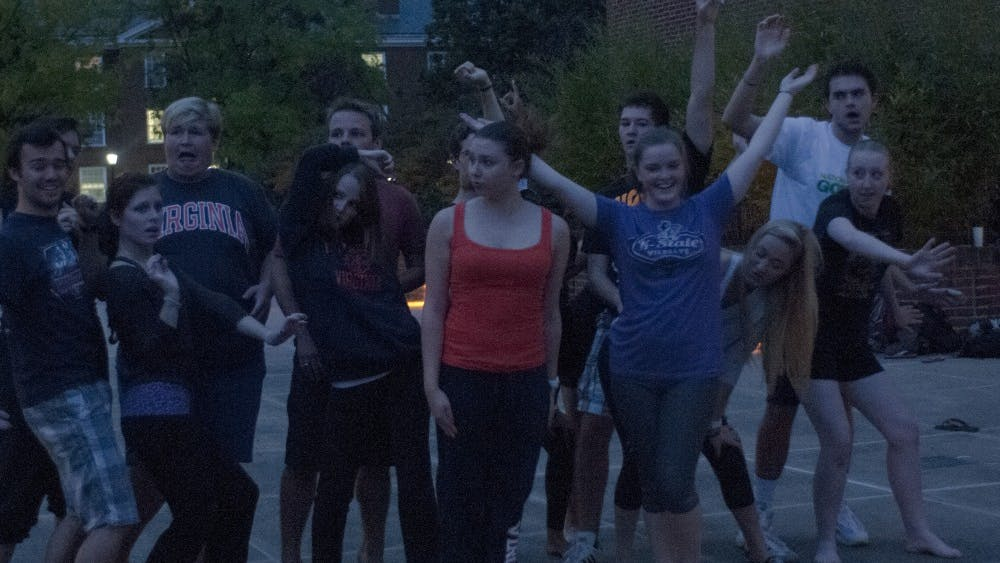 """The cast of the First Year Players' production of """"Legally Blonde The Musical"""" rehearses outside the Chemistry Building after the organization was unable to book a rehearsal space for Wednesday."""