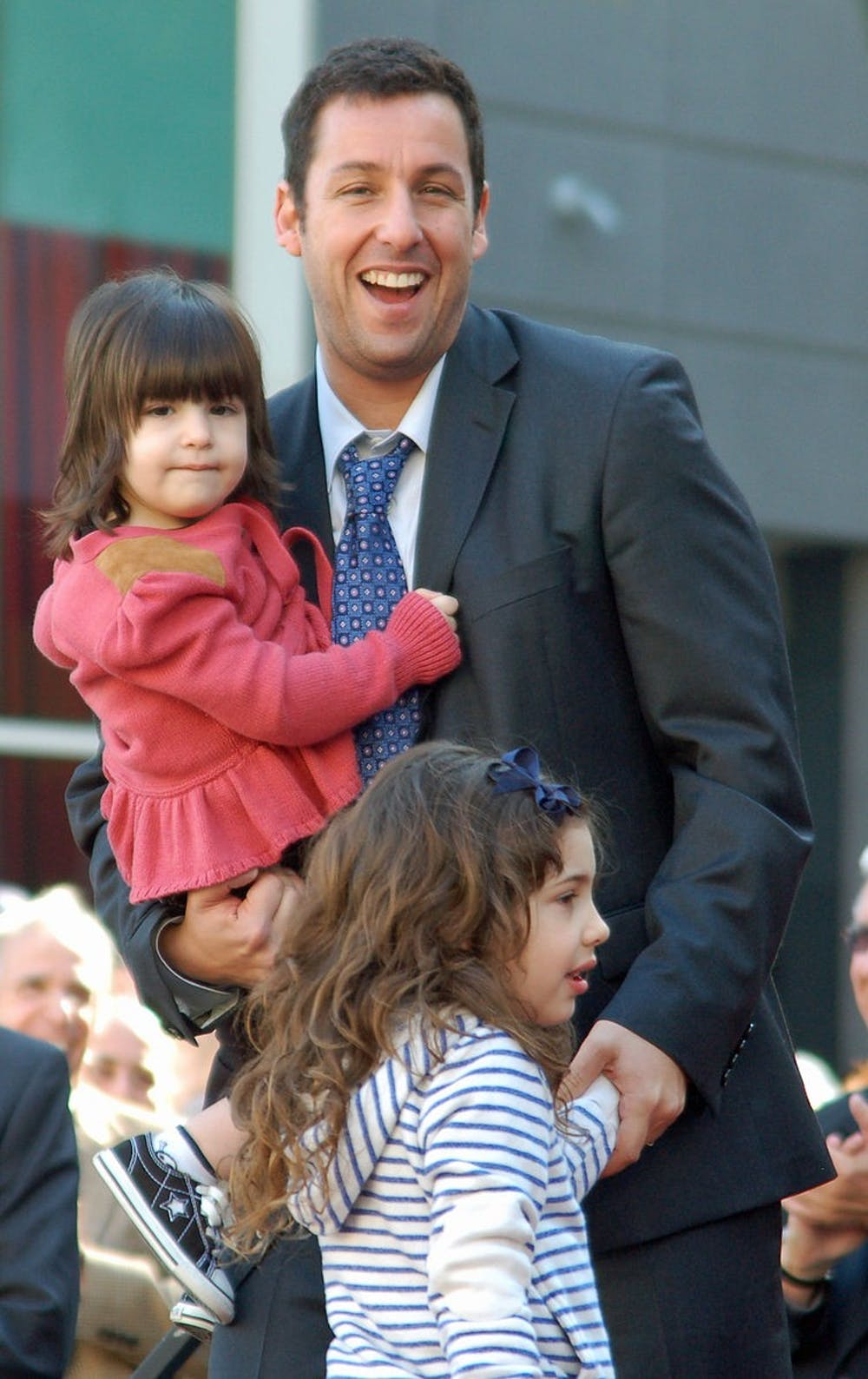 """<p>Adam Sandler stars in """"Hubie Halloween,"""" which has a large cast including his two daughters and wife.&nbsp;</p>"""