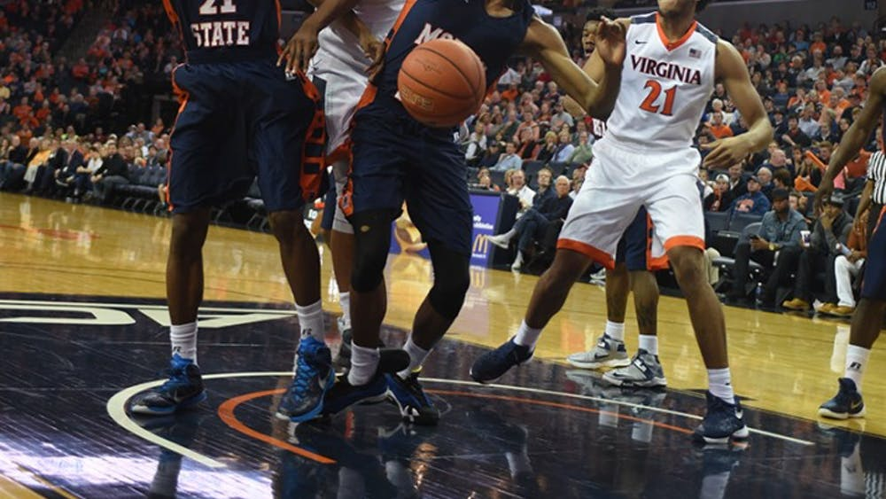 Senior forward Anthony Gill (No. 13) paced Virginia with 16 points on 6-for-8 shooting. He also snagged seven rebounds.