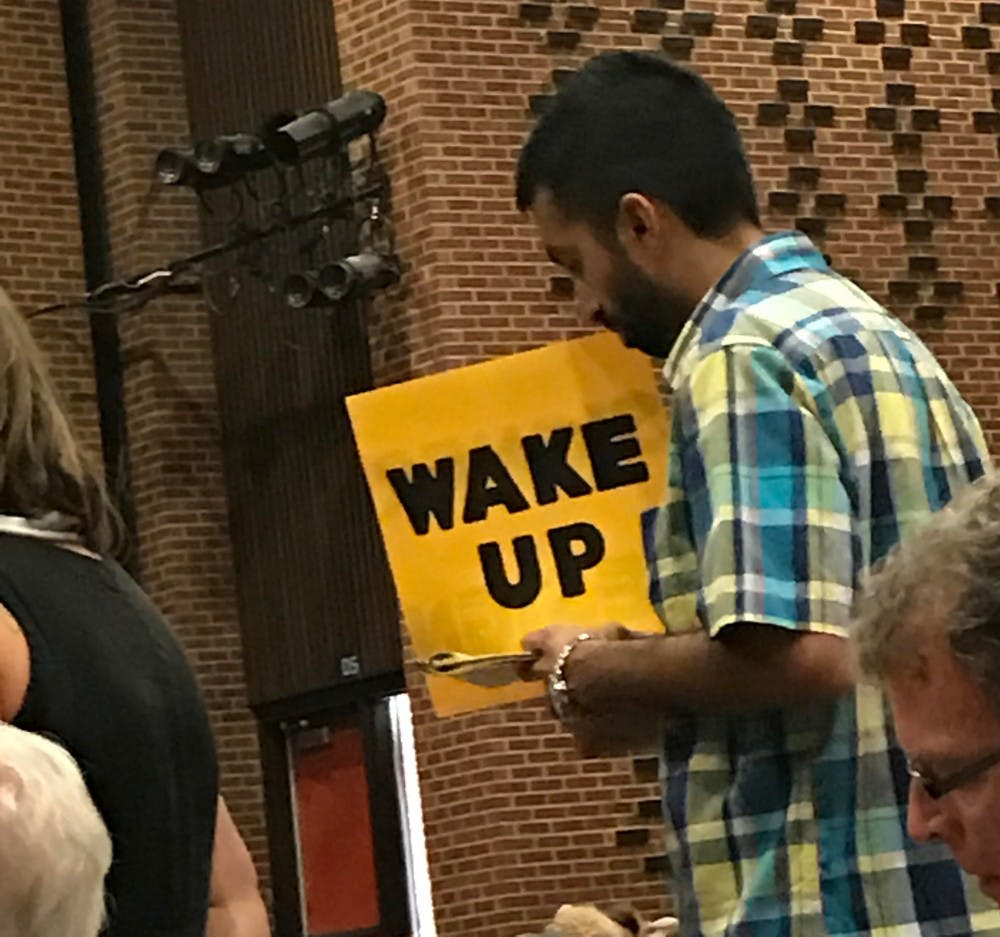 <p>One of the attendees at Sunday's town hall.&nbsp;</p>