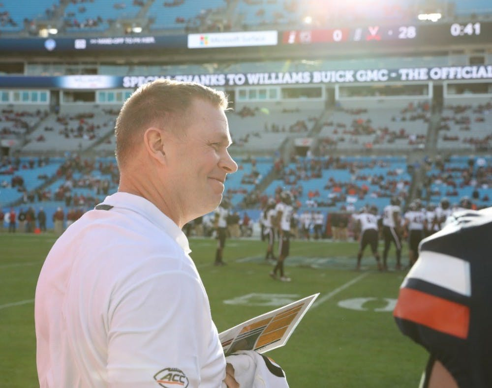 <p>Virginia football Coach Bronco Mendenhall has an overall record &nbsp;of 115-65 over his 14-year coaching career.&nbsp;</p>