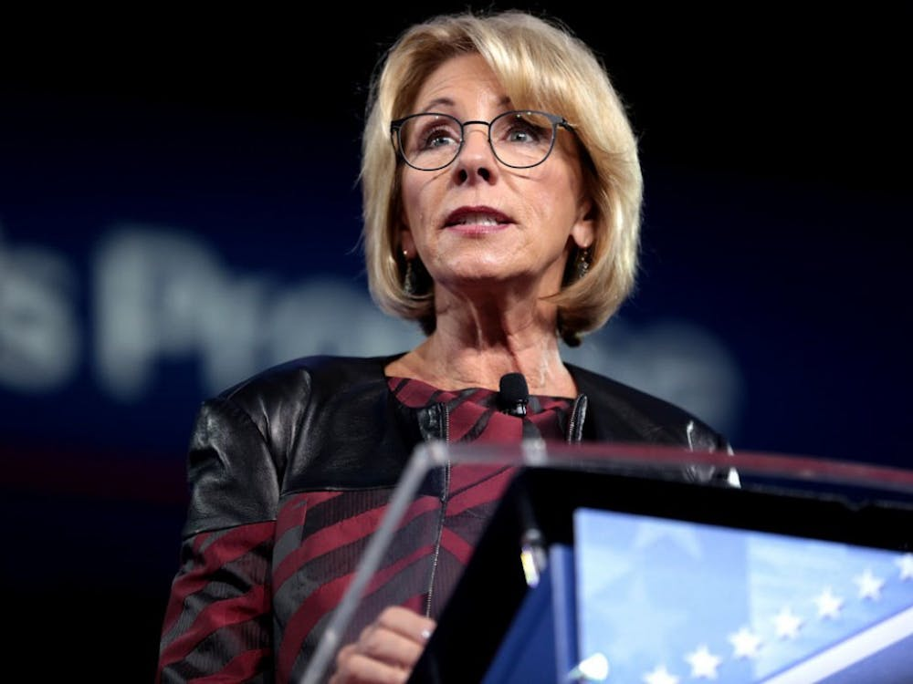 DeVos, in an internal notice, argued that the federal government's right to regulate these loan companies supersedes that of states.