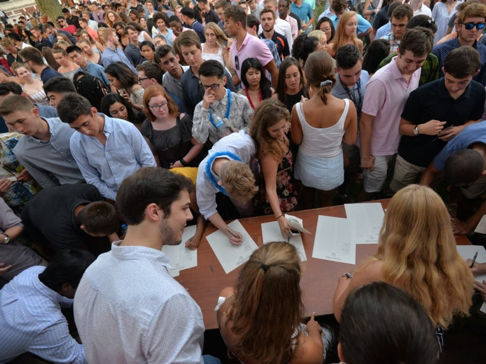 Students were invited to sign the University's honor pledge following the ceremony.