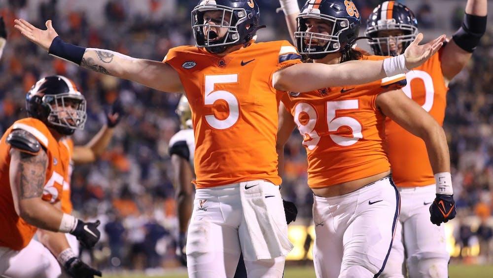 Virginia junior quarterback Brennan Armstrong celebrates after rushing for a touchdown in the third quarter against Georgia Tech Saturday night.