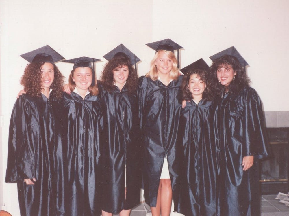 Meredith Kopit Levien (left) with her best friends in their graduation gowns. (Photo courtesy Meredith Kopit Levien)