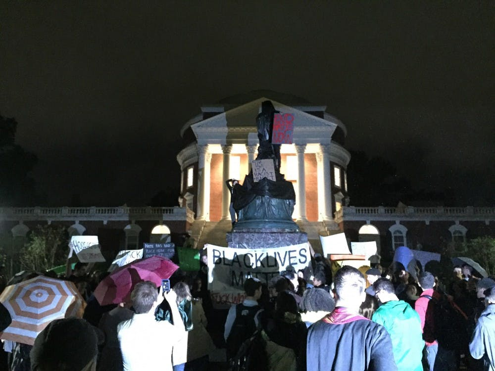 <p>U.Va. student protesters covered the Thomas Jefferson statue in front of the Rotunda Tuesday night.&nbsp;</p>