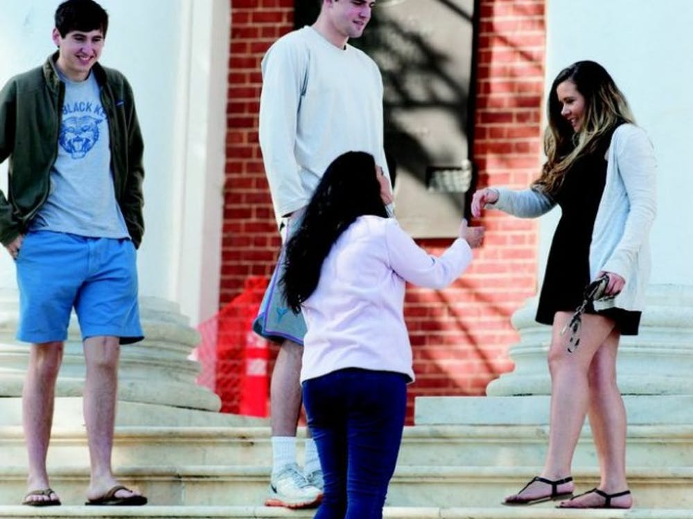 In a double-date Love Connection, junior guard Joe Harris and his friend Hart meet their dates on the steps of the Rotunda before heading to Basil for dinner.