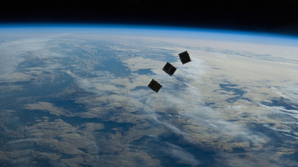 Student engineers prepare to monitor small space satellitewith their own ground control.