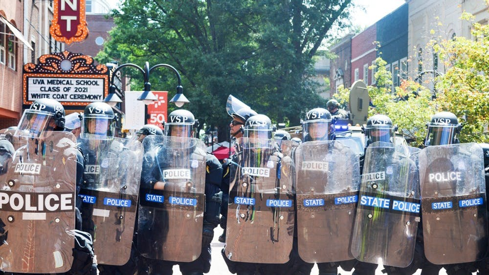 Police form a defensive line on the Downtown Mall during last August's Unite the Right rally.