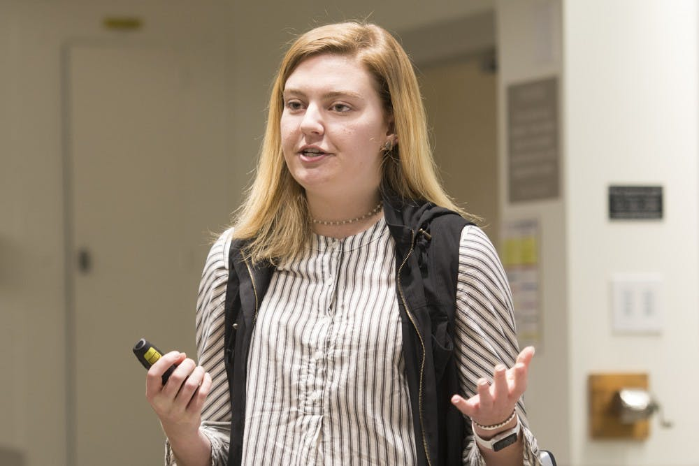 <p>University Democrats president Mary Alice Kukoski introduces Rogers and Parker to speak Wednesday.&nbsp;</p>