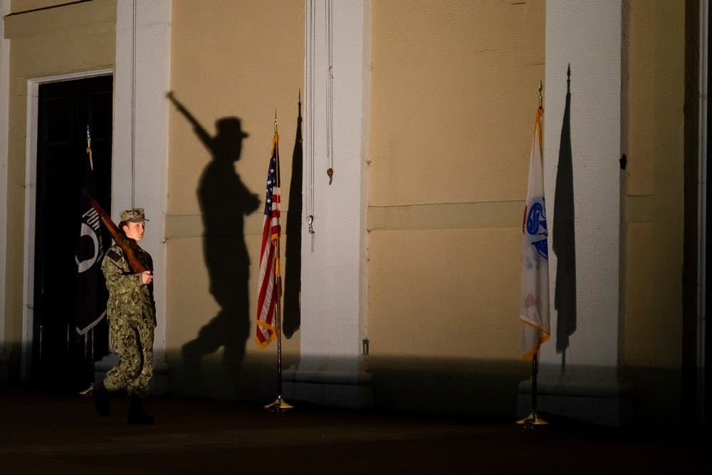 <p>The amphitheatre was lit to cast the shadows of the cadets and raise awareness of the vigil Monday night.</p>