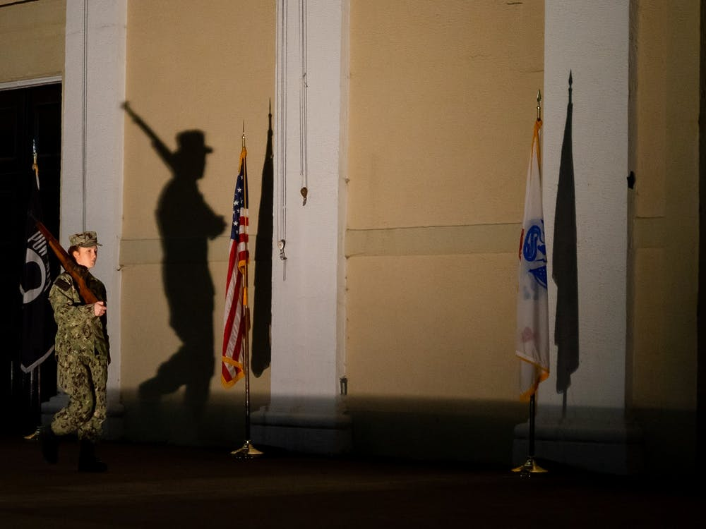 The amphitheatre was lit to cast the shadows of the cadets and raise awareness of the vigil Monday night.