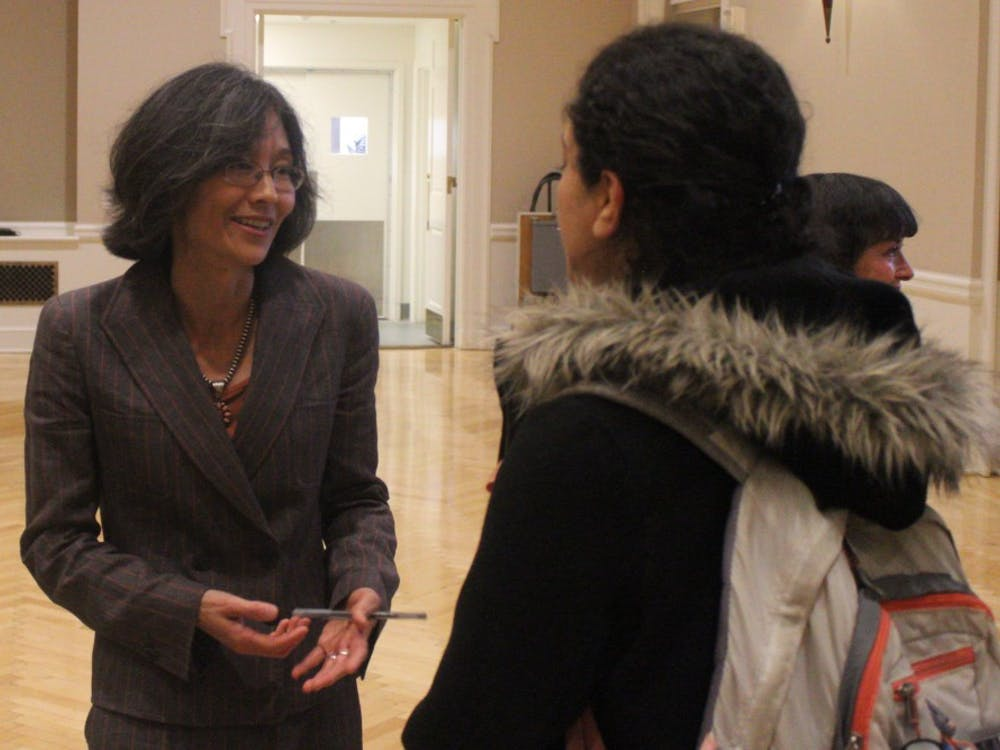 Dr. Sonya Shin speaks with a student during the Center for Global Health Research Symposium.