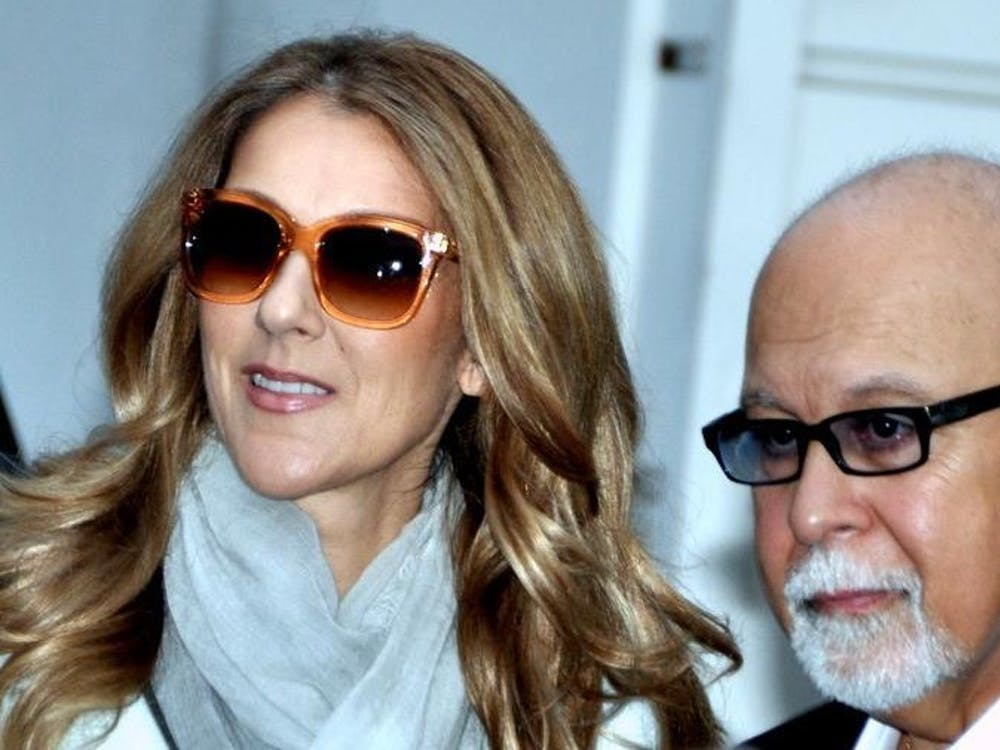 Céline Dion, pictured here with late husband René Angélil in 2012, explores moving on from grief in latest release.