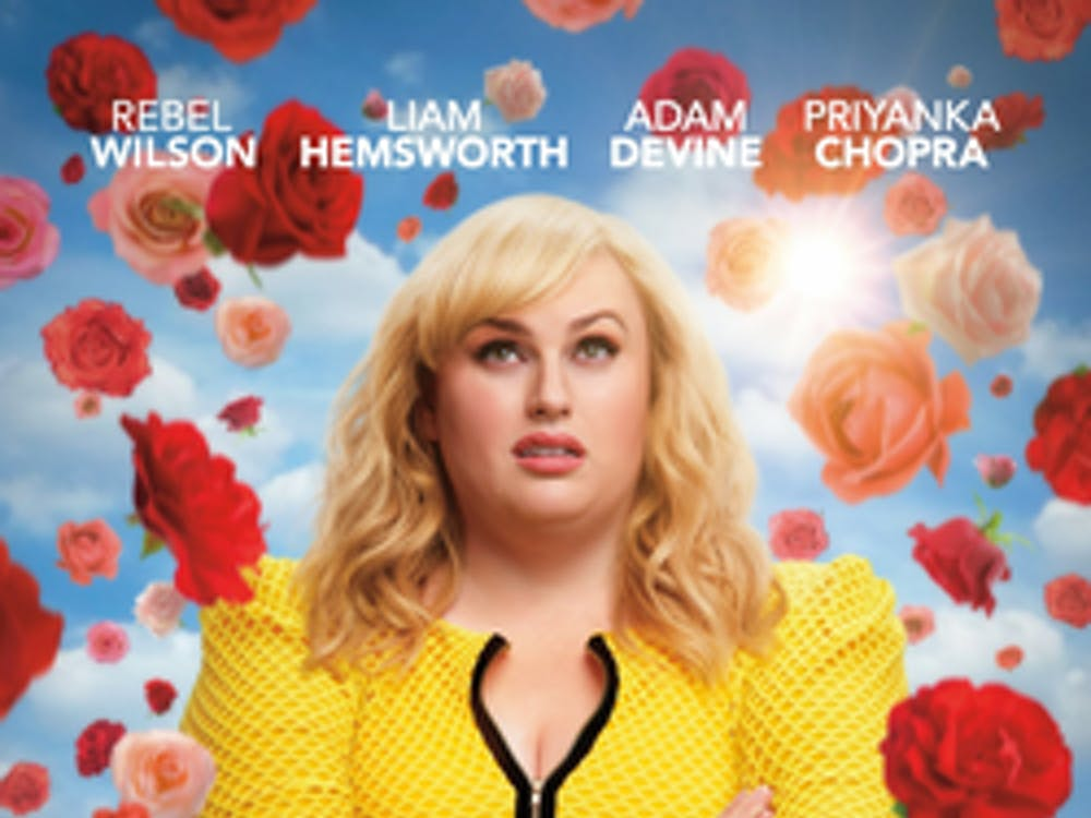 """""""Isn't It Romantic"""" stars Rebel Wilson as a dissatisfied architect flung into an alternate universe ruled by the tropes of the romantic comedy genre."""