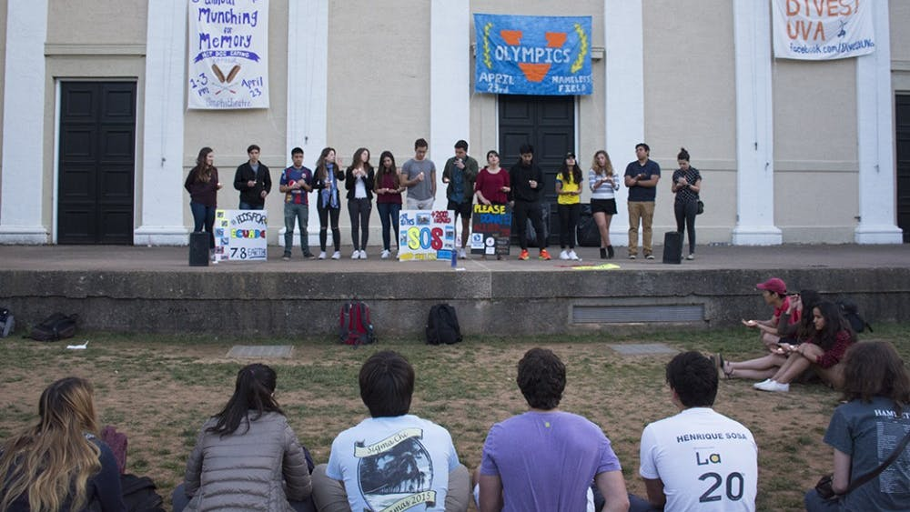 Hoos for Ecuador held a vigil and lit candles after sunsetin the Amphitheatre Sunday to remember victims of the recent earthquake in Ecuador.