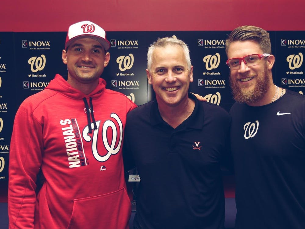 Former Virginia baseball players infielder Ryan Zimmerman and pitcher Sean Doolittle are pictured here with Virginia Coach Brian O'Connor.