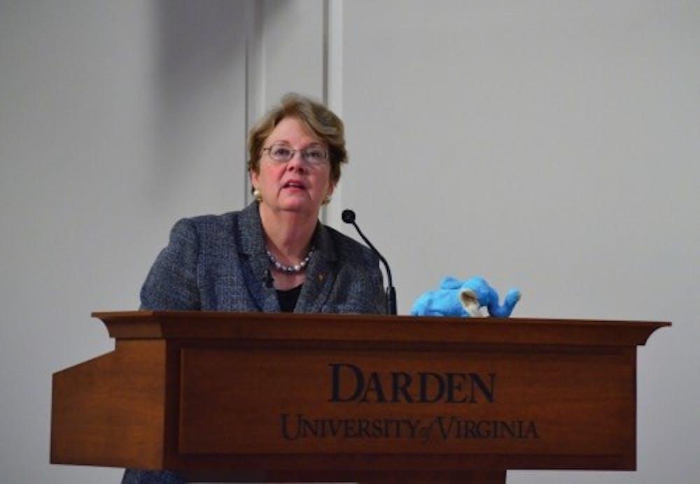 <p>University President Teresa Sullivan, above, addressing the faculty at the Darden School.</p>