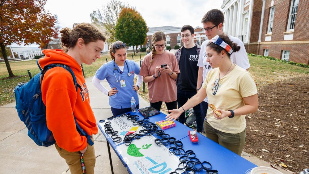 """JLC held a fundraising event and sold """"Our Hearts Are With Pittsburgh"""" wristbands to commemorate the victims of the synagogue shooting and raise money for the Tree of Life Synagogue and the Anti-Defamation League."""