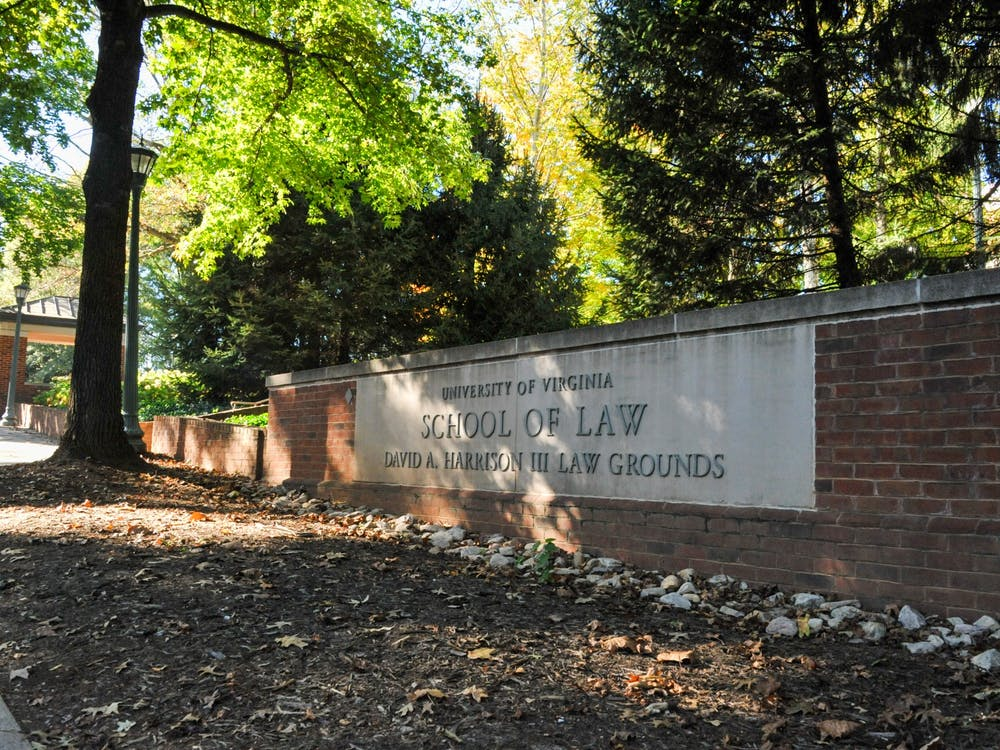 A group of students from the School of Law called on the University Friday to disband the Community-Oriented Policing Squad and instead reinvest in the Charlottesville community.